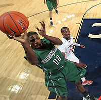 CHARLOTTESVILLE, VA- NOVEMBER 26:  Jarvis Williams #11 of the Green Bay Phoenix shoots the ball during the game on November 26, 2011 at the John Paul Jones Arena in Charlottesville, Virginia. Virginia defeated Green Bay 68-42. (Photo by Andrew Shurtleff/Getty Images) *** Local Caption *** Jarvis Williams