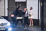 © Joel Goodman - 07973 332324 . 01/01/2017 . Manchester , UK . A fight involving several men and women breaks out on King Street West . People on a night out in Manchester City Centre , after midnight on January 1st 2017 . Photo credit : Joel Goodman