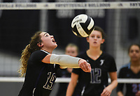 Fayetteville Ashley Ruff (19) digs, Thursday, September 10, 2020 during a volleyball game at Fayetteville High School in Fayetteville. Check out nwaonline.com/200911Daily/ for today's photo gallery. <br /> (NWA Democrat-Gazette/Charlie Kaijo)