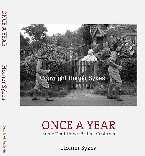 Once a Year, Some Traditional British Customs, second edition published by Dewi Lewis Publishing in July 2016. <br /> £33-00 including p&p in the UK. <br /> Signed and or dedicated let me know please.  Email CONTACT AT THE BOTTOM OF EACH PAGE payment by Paypal or BACS.  <br /> <br /> Hardback with Dust jacket 290mm x 235mm, ( A4ish) 216 pages <br /> 134 duotone photographs <br /> ISBN: 978-1-911306-03-0 <br /> <br /> There are many 'new' images and different customs not included in the 1977 edition. I have that edition available too.