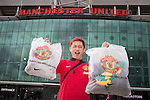 © Joel Goodman - 07973 332324 . 27/01/2014 . Manchester , UK .  HUNG-JUI LIN (correct) (27, tourist from Taiwan) poses with his shopping in front of the stadium . Fans with new MATA 8 shirts in front of Old Trafford Football Ground as it's announced that Spaniard Juan Mata ( Juan Manuel Mata García ) has signed for Manchester United  . Photo credit : Joel Goodman
