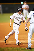 Lakeland Flying Tigers shortstop Jared Reaves (12) is congratulated by manager Dave Huppert (24) while running the bases after hitting a home run during a game against the Jupiter Hammerheads on March 14, 2016 at Henley Field in Lakeland, Florida.  Lakeland defeated Jupiter 5-0.  (Mike Janes/Four Seam Images)
