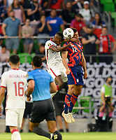 AUSTIN, TX - JULY 29: Miles Robinson #12 of the United States and Mohmmed Muntari #9 of Qatar go up for a header during a game between Qatar and USMNT at Q2 Stadium on July 29, 2021 in Austin, Texas.
