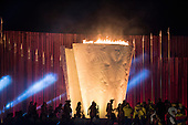 Indigenous participants pass in front of the Sacred Flame during the opening ceremony in the Green Arena at the first ever International Indigenous Games, in the city of Palmas, Tocantins State, Brazil. Photo © Sue Cunningham, pictures@scphotographic.com 23rd October 2015