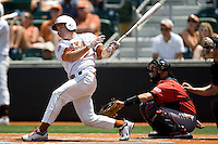 Second baseman Jordan Etier #7 of the Texas Longhorns swings against Texas Tech on April 17, 2011 at UFCU Disch-Falk Field in Austin, Texas. (Photo by Andrew Woolley / Four Seam Images)