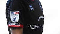 A close up of the Not Today, Not Any Day anti-racism badge of the shirt of Lincoln City's Jorge Grant<br /> <br /> Photographer Chris Vaughan/CameraSport<br /> <br /> The EFL Sky Bet League One - Milton Keynes Dons v Lincoln City - Saturday 19th September 2020 - Stadium MK - Milton Keynes<br /> <br /> World Copyright © 2020 CameraSport. All rights reserved. 43 Linden Ave. Countesthorpe. Leicester. England. LE8 5PG - Tel: +44 (0) 116 277 4147 - admin@camerasport.com - www.camerasport.com
