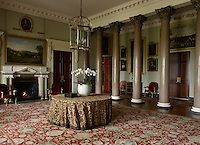 The entrance hall is punctuated by a series of marble Corinthian columns