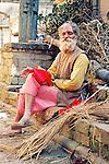 A gentleman enjoys a beedi cigarette in the streets of Kathmandu.