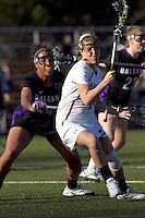 Boston College attacker Brooke Blue (4) on the attack as University at Albany defender Stephanie Kempf (21) defends. University at Albany defeated Boston College, 11-10, at Newton Campus Field, on March 30, 2011.