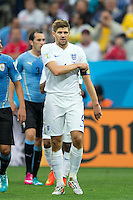 Steven Gerrard of England pulls at his captains armband