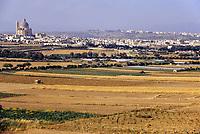 Gozo, Malta.  Farmland, town of Xewkija in background.