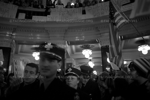 Madison, Wisconsin.<br /> USA<br /> Feb 2011 <br /> <br /> Opponents to the government's bill to eliminate collective bargaining rights for many state workers protesters in the rotunda of the state capital. Gov. Scott Walker's plan to require public workers to pay more of their health insurance and pensions, effectively cutting the take-home pay of many 57%. Madison schools were closed for several days as employees call sick to lobby the bill.
