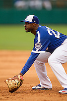 Oklahoma City Dodgers first baseman O'Koyea Dickson (23) on defense during the Pacific Coast League baseball game against the Nashville Sounds on June 12, 2015 at Chickasaw Bricktown Ballpark in Oklahoma City, Oklahoma. The Dodgers defeated the Sounds 11-7. (Andrew Woolley/Four Seam Images)
