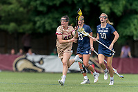 NEWTON, MA - MAY 22: Sydney Scales #45 of Boston College brings the ball forward during NCAA Division I Women's Lacrosse Tournament quarterfinal round game between Notre Dame and Boston College at Newton Campus Lacrosse Field on May 22, 2021 in Newton, Massachusetts.