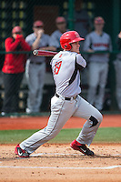 David MacKinnon (19) of the Hartford Hawks follows through on his swing against the Virginia Cavaliers at The Ripken Experience on February 27, 2015 in Myrtle Beach, South Carolina.  The Cavaliers defeated the Hawks 5-1.  (Brian Westerholt/Four Seam Images)