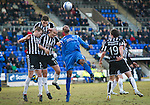 St Johnstone v St Mirren....22.01.11  .Michael Duberry closed down by four St Mirren players Jim Goodwin, Lee Mair, Paul McGowan and Marc McAusland.Picture by Graeme Hart..Copyright Perthshire Picture Agency.Tel: 01738 623350  Mobile: 07990 594431
