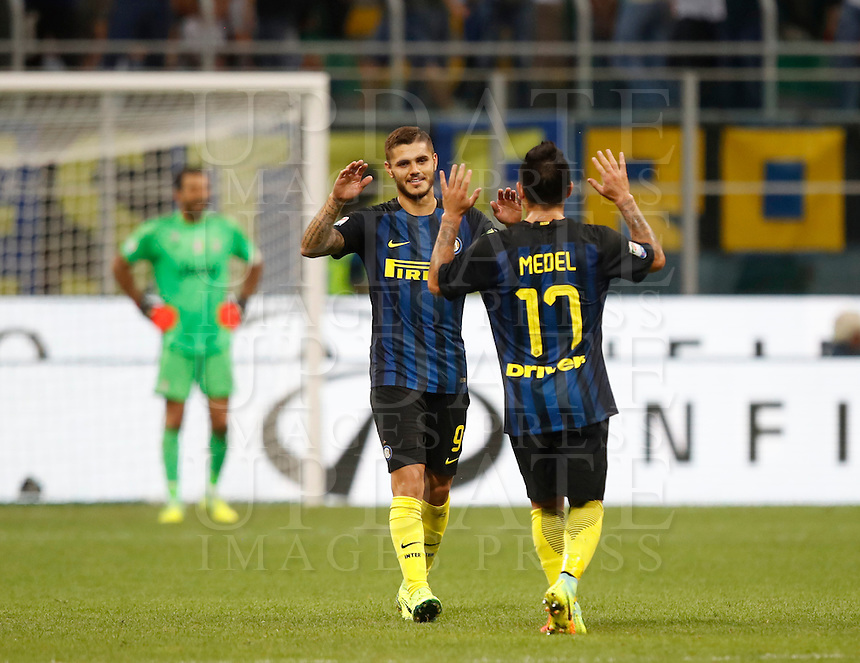 Calcio, Serie A: Inter vs Juventus. Milano, stadio San Siro, 18 settembre 2016.<br /> Inter's Mauro Icardi, left, celebrates with teammate Gary Medel after scoring during the Italian Serie A football match between FC Inter and Juventus at Milan's San Siro stadium, 18 September 2016.<br /> UPDATE IMAGES PRESS/Isabella Bonotto