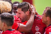 ORLANDO, FL - APRIL 24: Omar Gonzálex #44 of Toronto FC celebrates a goal during a game between Vancouver Whitecaps and Toronto FC at Exploria Stadium on April 24, 2021 in Orlando, Florida.