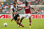Juventus' player Grigoris Kastanos contests the ball against South China's player Mahama Awai during the South China vs Juventus match of the AET International Challenge Cup on 30 July 2016 at Hong Kong Stadium, in Hong Kong, China.  Photo by Marcio Machado / Power Sport Images