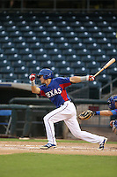 Jose Cardona #16 of the AZL Rangers bats against the AZL Cubs at Surprise Stadium on July 6, 2014 in Surprise, Arizona. AZL Rangers defeated the AZL Cubs, 7-5. (Larry Goren/Four Seam Images)