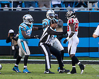 The Carolina Panthers defeated the Atlanta Falcons 34-10 in an inter-division rivalry played in Charlotte, NC at Bank of America Stadium.  An official separates Carolina Panthers strong safety Quintin Mikell (27), Carolina Panthers cornerback Melvin White (23) and Atlanta Falcons wide receiver Harry Douglas (83)