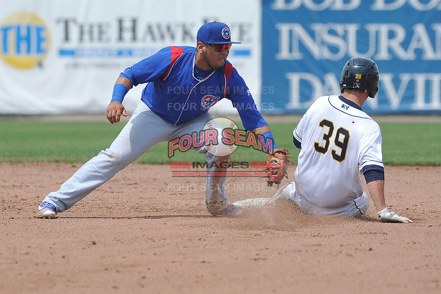 Jack Kruger (39) of the Burlington Bees slides into second base ahead of the tag by South Bend Cubs shortstop Isaac Paredes (16) during the game at Community Field on May 10, 2017 in Burlington, Iowa.  The Bees defeated the Cubs 4-3 in 10 innings.  (Dennis Hubbard/Four Seam Images)