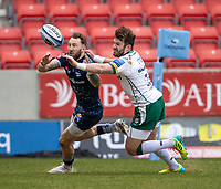 21st March 2021; AJ Bell Stadium, Salford, Lancashire, England; English Premiership Rugby, Sale Sharks versus London Irish; Byron McGuigan of Sale Sharks and James Stokes of London Irish try to grab the ball