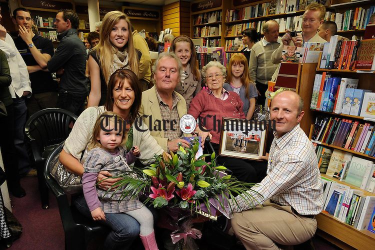 Author Dave Courtney with special guest Kevin Myers and family members; Mrs Linda Courtney, his mother Sylvia Courtney and children; Ellen, Alison, Niamh and Anna the launch of his first book  entitled Nine Lives at Ennis Bookshop. Photograph by John Kelly.