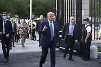 =trum= returns after posing with a bible outside St. John's Episcopal Church after delivering remarks in the Rose Garden at the White House in Washington, DC, USA, 01 June 2020. Trump addressed the nationwide protests following the death of George Floyd in police custody.<br /> Credit: Shawn Thew / Pool via CNP/AdMedia