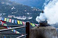 Trongsa, Bhutan. Trongsa Dzong (Monastery-Fortress) in early morning.  Trongsa Royal Heritage Museum upper left.