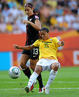 Alex Morgan (l) of team USA and Francielle of team Brazil during the FIFA Women's World Cup at the FIFA Stadium in Dresden, Germany on July 10th, 2011.