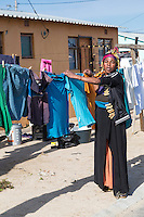 South Africa, Cape Town.  Woman doing her Laundry, Wallacedene Township,  Kraaifontein.