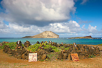 A heiau or sacred temple with Manana (Rabbit) and Kaohikaipu Islands in the distance; the islands are bird sanctuaries off the coast near the Makapu'u area, East O'ahu.