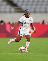 TOKYO, JAPAN - JULY 21: Crystal Dunn #2 of the USWNT passes during a game between Sweden and USWNT at Tokyo Stadium on July 21, 2021 in Tokyo, Japan.