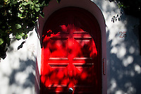 A red door to a home is seen on Tuesday, Sept. 22, 2015, on the island of Capri in Italy. (Photo by James Brosher)