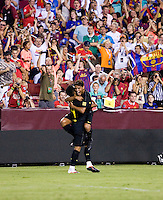 Thiago (4) of Barcelona celebrates his goal with teammate Jonathan Dos Santos (18) during the friendly at FedEX Field in Landover, MD.  Manchester United defeated FC Barcelona, 2-1.