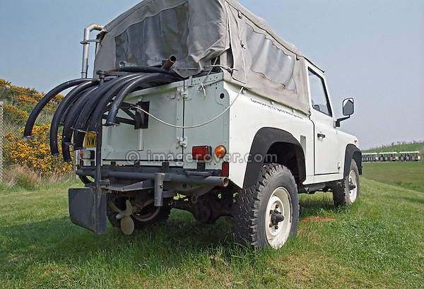 Unusual amphibious Land Rover Defender 90 with its hoops for the flotation bags sticking out of the back, Gaydon, UK. --- No releases available. Automotive trademarks are the property of the trademark holder, authorization may be needed for some uses.