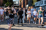 © Joel Goodman - 07973 332324 - all rights reserved . 25/08/2019. Manchester, UK. Armed police patrol the venue as fans of Ariana Grande and other musical acts gather at Mayfield Depot ahead of performances this evening . Manchester's annual Gay Pride festival , which is the largest of its type in Europe , celebrates LGBTQ+ life . Photo credit : Joel Goodman
