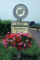 road sign, Switzerland, La Cote, Vaud, Speed limit sign decorated with red and pink flowers