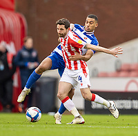 6th February 2021; Bet365 Stadium, Stoke, Staffordshire, England; English Football League Championship Football, Stoke City versus Reading; Joe Allen of Stoke City controls the ball while under pressure from Andy Rinomhota of Reading