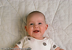 5 month old baby girl portrait, closeup, smiling horizontal