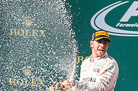 March 15, 2015: Lewis Hamilton (GBR) #44 (1st) sprays champagne on the podium at the 2015 Australian Formula One Grand Prix at Albert Park, Melbourne, Australia. Photo Sydney Low