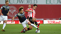 Christian Norgaard of Brentford and Barnsley's Callum Styles challenge for the ball during Brentford vs Barnsley, Sky Bet EFL Championship Football at Griffin Park on 22nd July 2020