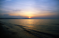 Pictured: The sun rises over Swansea Bay, as seen from West Cross in south Wales, UK. Wednesday 21 June 2017<br />