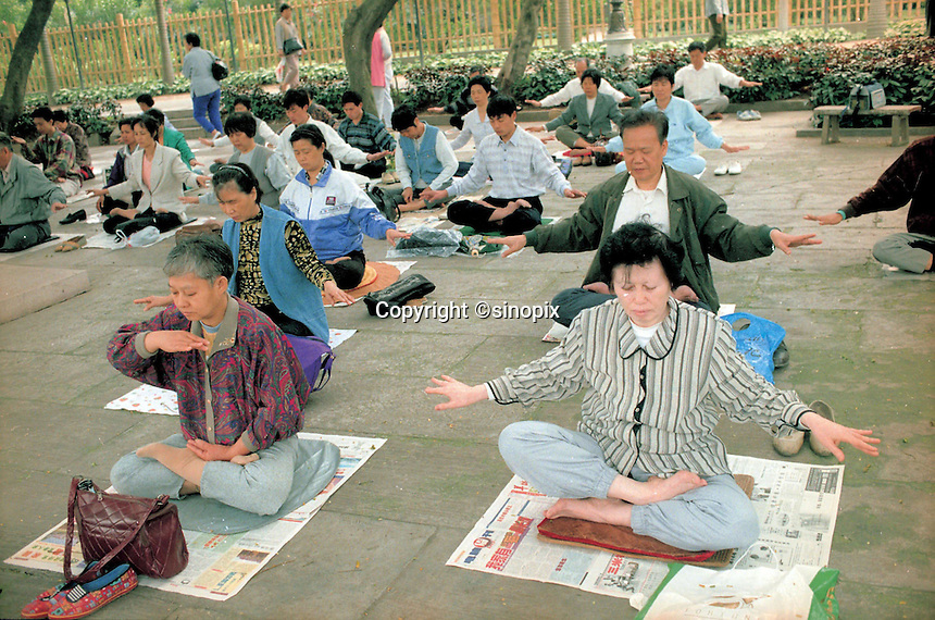"Members of the Fa Lun Gong cult meditate, in Guangzhou, in the typical cult-like fashion as taught by their U.S. based leader, Li Hongzhi.  Followers of the cult, that according to official government figures number over 70 million, held the biggest demonstration in China, since Tiananmen in 1989,  last Sunday. The Communist Government was caught unawares and has since adopted ""all means of punishment""  to prevent further unrest since the demonstration."