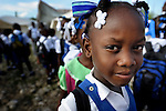 Students at the Notre Dame de Petits school at the beginning of a school day in Port-au-Prince, Haiti. The school's building collapsed in the January 2010 earthquake, and while some classes are conducted in the ruins, other classes meet in large tents provided by International Orthodox Christian Charities.