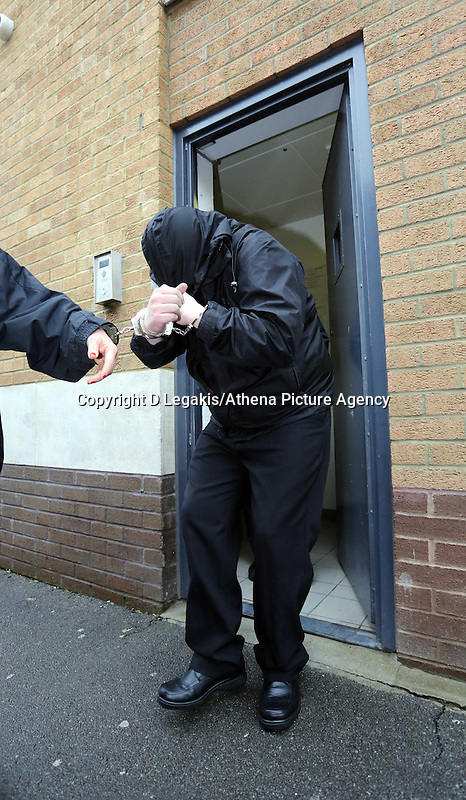 Pictured: Robert Riley is led handcuffed to a waiting prison van after being sentenced by Swansea Magistrates. Thursday 08 May 2014<br />