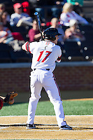Kyle Seeger (17) of the Cincinnati Bearcats at bat against the Radford Highlanders at Wake Forest Baseball Park on February 22, 2014 in Winston-Salem, North Carolina.  The Highlanders defeated the Bearcats 6-5.  (Brian Westerholt/Four Seam Images)