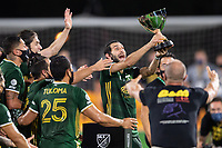 LAKE BUENA VISTA, FL - AUGUST 11: Diego Valeri #8 of the Portland Timbers lifts the trophy after a game between Orlando City SC and Portland Timbers at ESPN Wide World of Sports on August 11, 2020 in Lake Buena Vista, Florida.