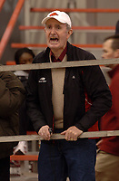 Arkansas Democrat-Gazette/MICHAEL WOODS<br /><br />University of Arkansas track coach John McDonnell watches his team Saturday afternoon at the Tyson Invitational track meet in Fayetteville.<br /><br />2/10/07